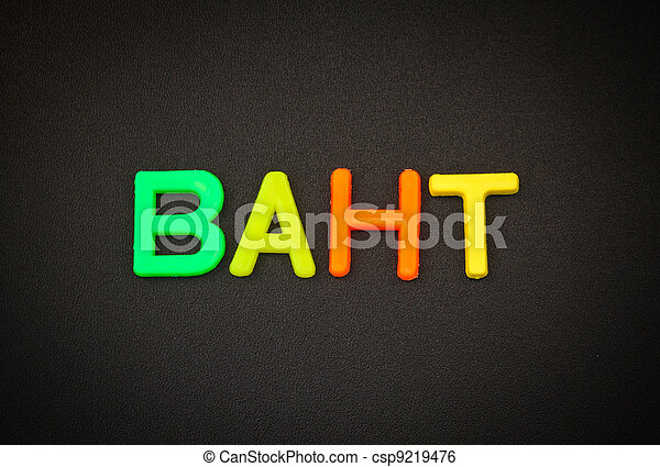 Baht in colorful toy letters on black background - csp9219476