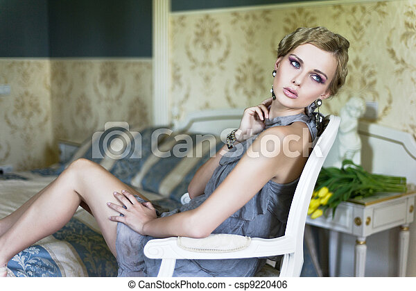 blonde beauty in a vintage room - csp9220406