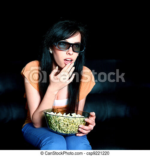 Young woman watching 3D TV - csp9221220