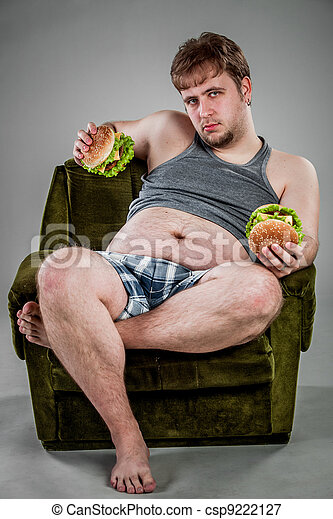 fat man eating hamburger - csp9222127