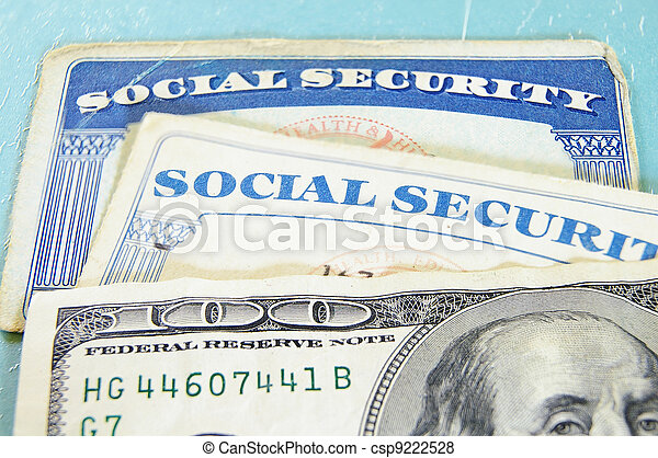 closeup of US money and Social Security cards - csp9222528