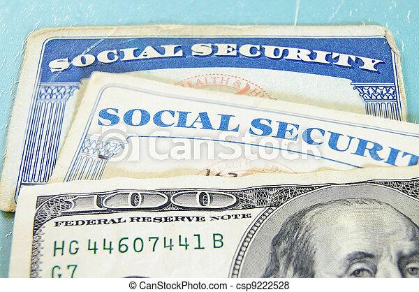 closeup of US money and Social Security cards - csp9222528