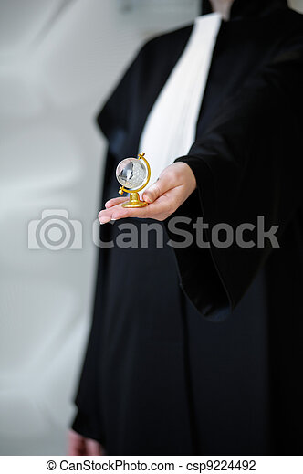 Barrister in wig holding globe in hand - csp9224492
