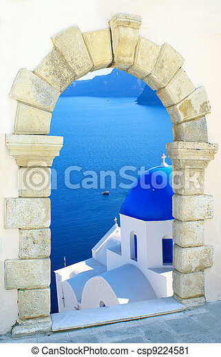 Traditional greek church  through an old window in Santorini island, Greece - csp9224581