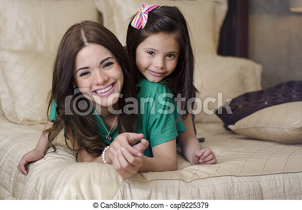 Mother and daughter in the bedroom - csp9225379