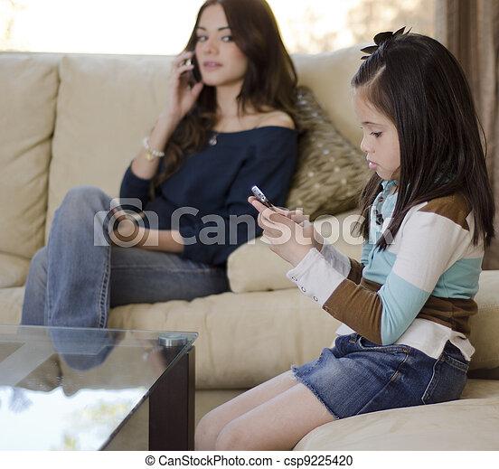 Mom supervising daughter - csp9225420