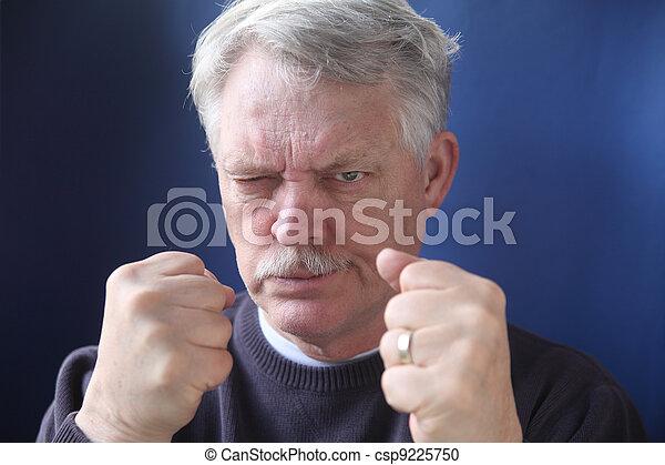 hostile and combative senior man - csp9225750
