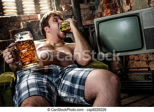 fat man eating hamburger - csp9226226