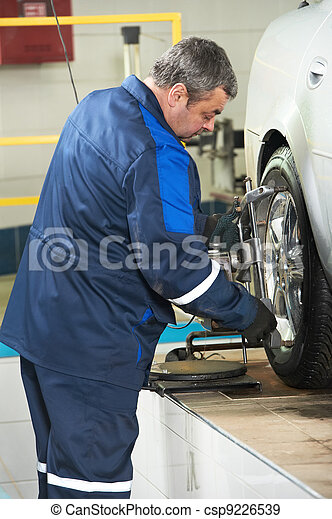 auto mechanic at wheel alignment work - csp9226539