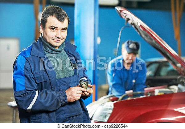 happy mechanic technician at service station - csp9226544
