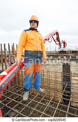 builder worker at concrete pouring work - csp9226545