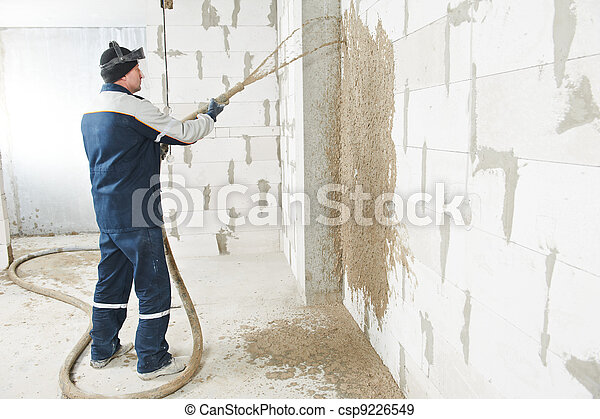 Plasterer at stucco work with liquid plaster - csp9226549