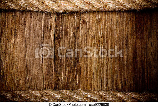 rope on weathered wood background - csp9226838