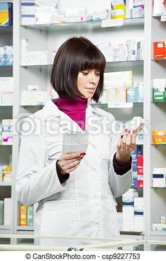 Pharmacy chemist woman in drugstore - csp9227753