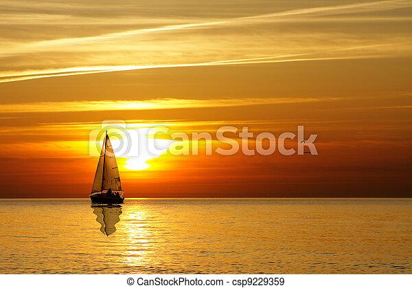 Sailing at sunset - csp9229359