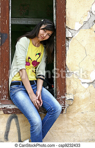Girl sits on the window sill - csp9232433