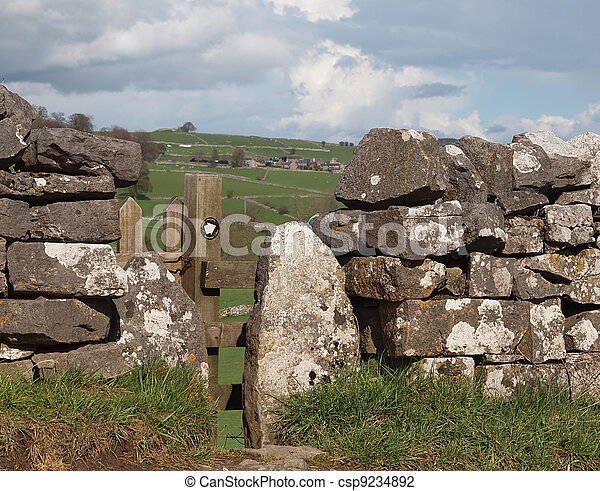 Footpath Stile in Dry Stone Wall - csp9234892