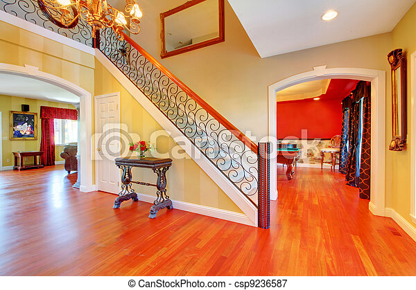 Large hallway with gold and red walls. - csp9236587