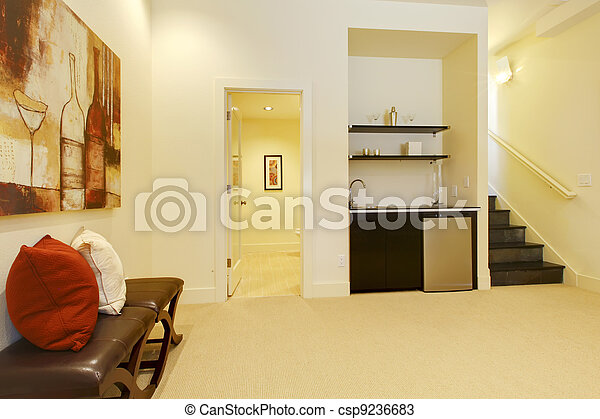 Living room staircase with bathroom and bar. - csp9236683