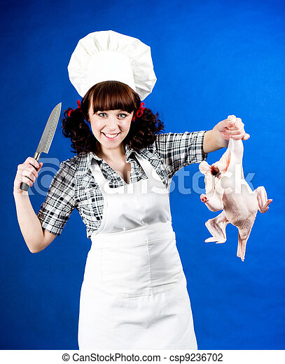 cook woman holds a Crude hen - csp9236702