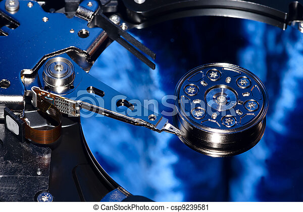 The disassembled hard disk of the computer on a dark blue background