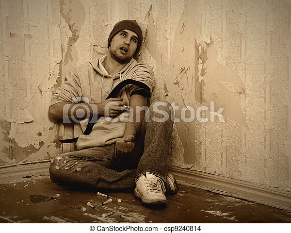 bad man - addict  with a syringe using drugs   - csp9240814