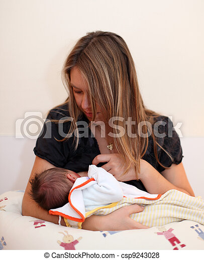 Newborn baby breast feeding - csp9243028