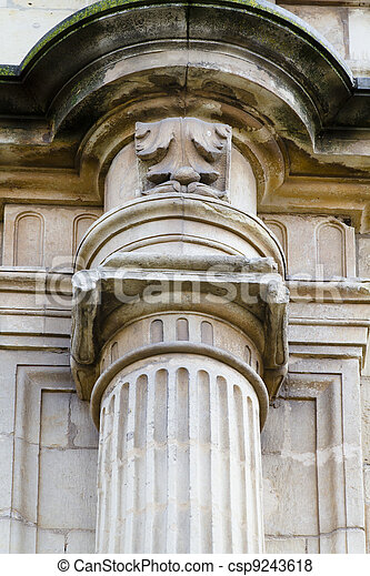 Detail of an ancient Greek pillar of ionic order ,facade of the University of Alcala de Henares, Madrid, Spain - csp9243618