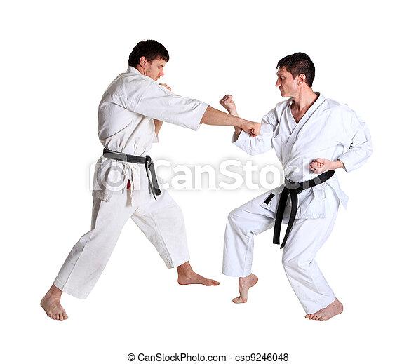 Karate. Men in a kimono. Battle sports capture - csp9246048