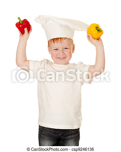 boy in cooking hat with vegetables. Kid helping in food preparing concept. - csp9246136