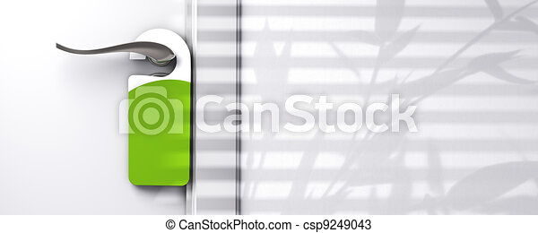 green blank plastic door hanger fixed onto a knob, wall with free space, room for text, shadow of a plant, real estate or hotel communication concept - csp9249043