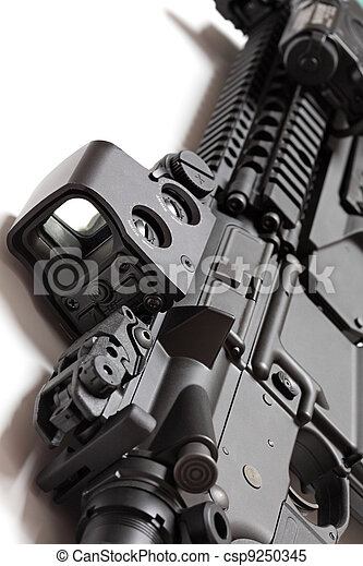 Modern tactical laser sght on assault carbine close-up. - csp9250345
