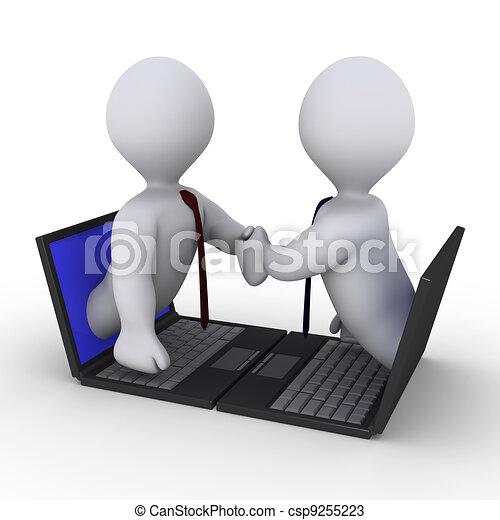 Businessmen handshake through laptop - csp9255223