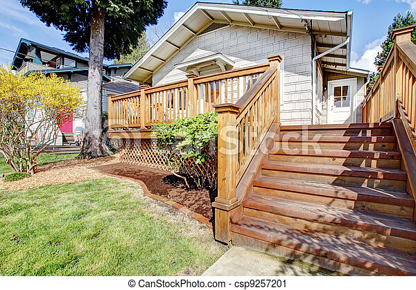 Small white house with deck and steps. - csp9257201