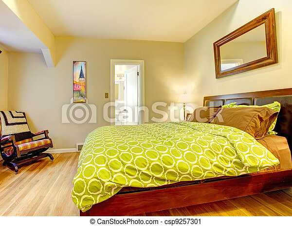 Modern bedroom with bright green bed spread. - csp9257301