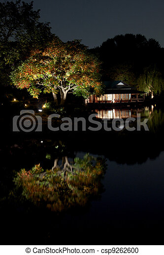 Japanese garden at night with a small hut on lakeside  - csp9262600