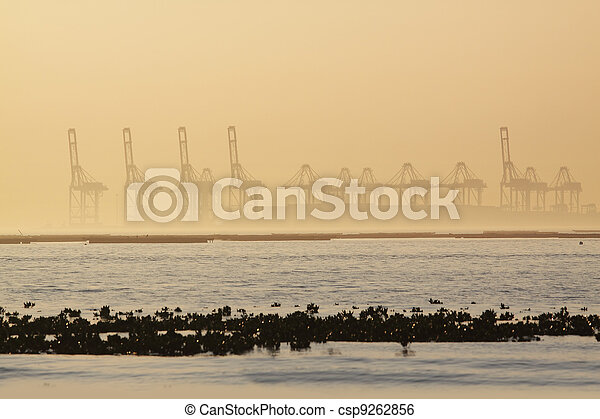 container cranes on a foggy morning - csp9262856