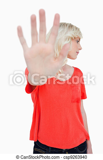 Woman trying to escape making the stop sign with hand while leaning her head - csp9263940