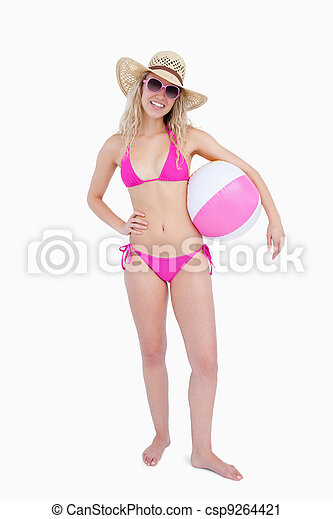 Smiling teenager in beachwear holding a beach ball - csp9264421