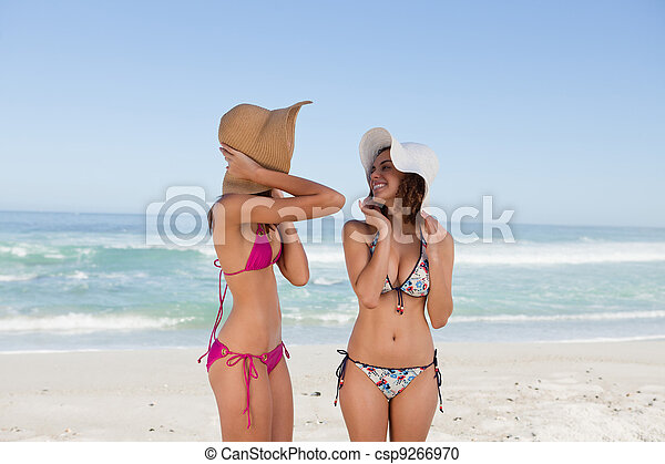 Attractive teenagers standing in front of the sea in beachwear - csp9266970