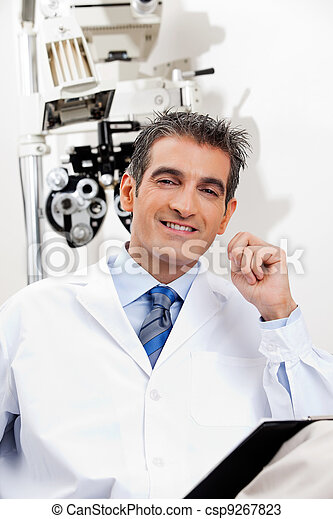 Smiling Optometrist At His Clinic - csp9267823