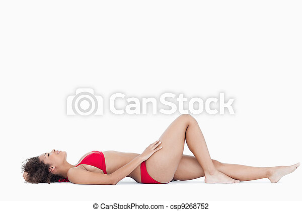 Attractive woman in swimsuit lying down - csp9268752