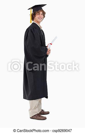 Profile view of a student in graduate robe - csp9269047