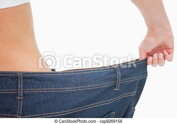 Close-up of a woman waist in a too big pants - csp9269156