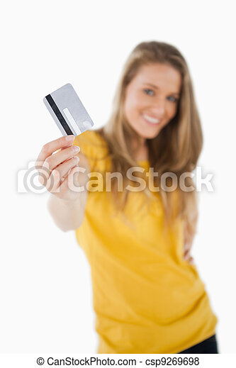 Portrait of a blonde student tending a credit card - csp9269698