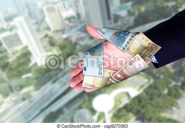 Cityscape and hands holding banknotes - csp9270363