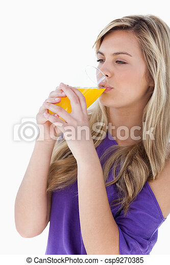 Young blonde woman drinking an orange juice - csp9270385