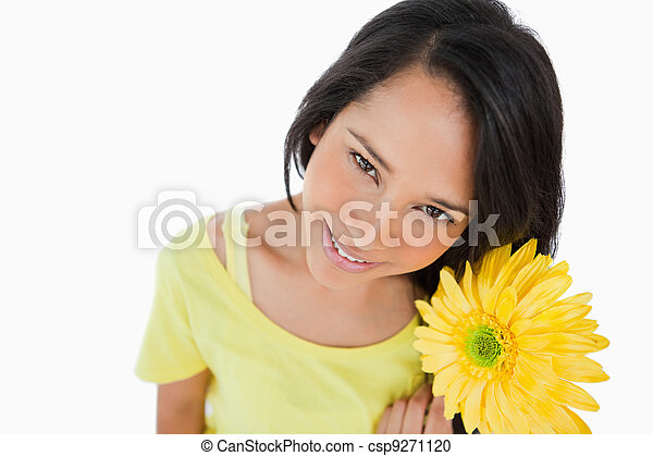 High-angle view of a Latino woman holding a gerbera - csp9271120