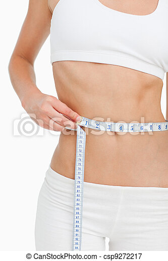 Close-up of a slim woman measuring her waist - csp9272217