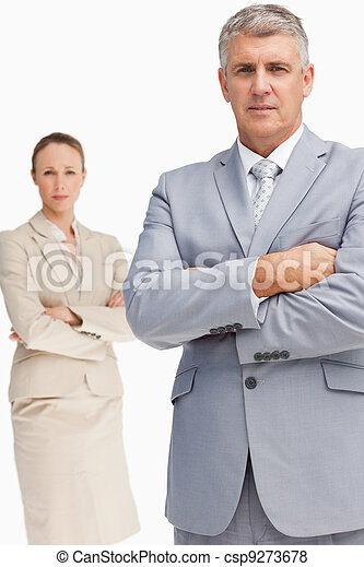 Serious business people standing  with folded arms - csp9273678